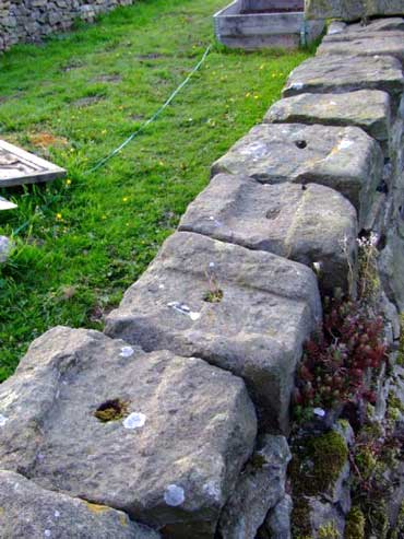 capping stones on embankment wall