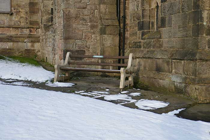 Community seat outside St Mary's Church, Crich